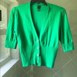 Take out large green cardigan.